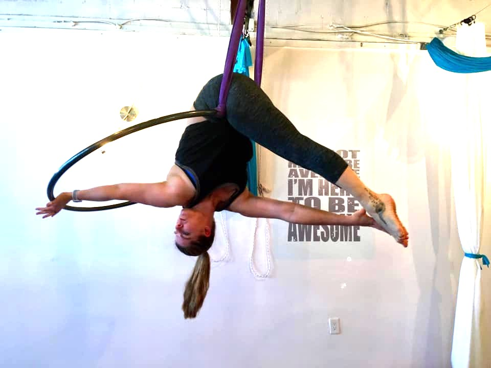 Aerial Hoop / Lyra at Newark, DE location -  We start lower to the ground to learn how the body moves before adding on. Learn great skills in a safe fun way for us non-performing folks who just want to do some cool stuff to stay fit or if your foundation will be set to want to join the circus. Photo: Abby