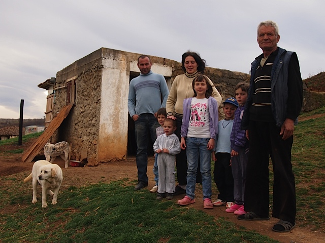 The Dimic family in front of their stable