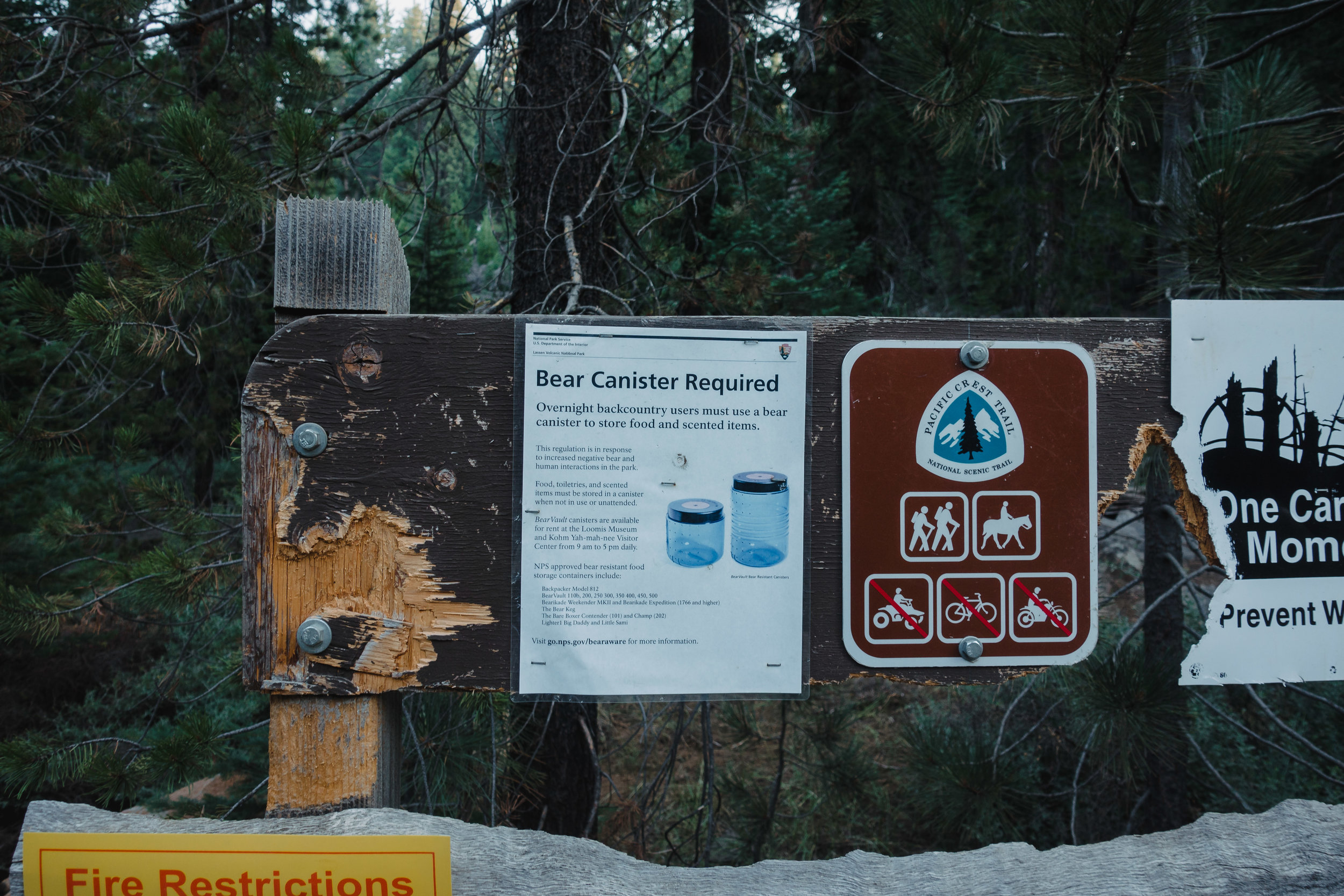 Sign about bear canister requirement.