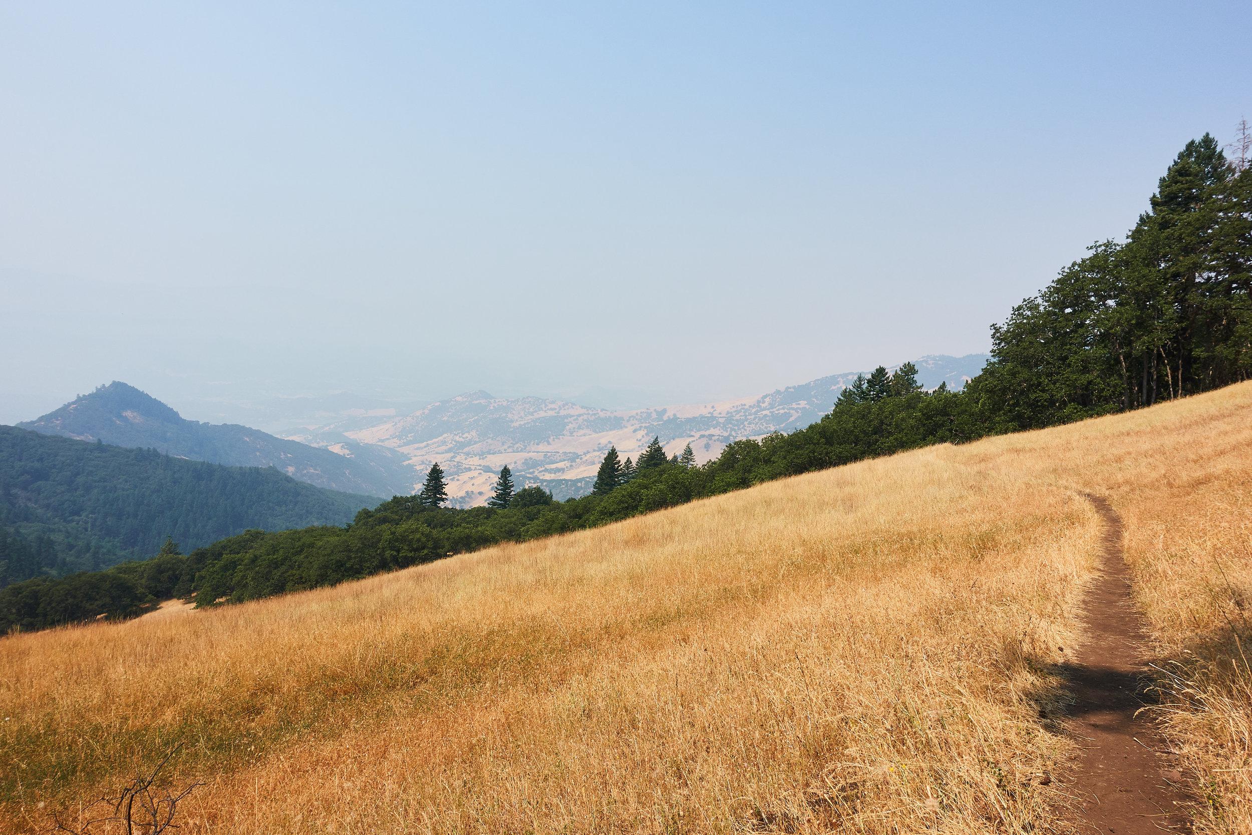 Smoke and sun burned hills.