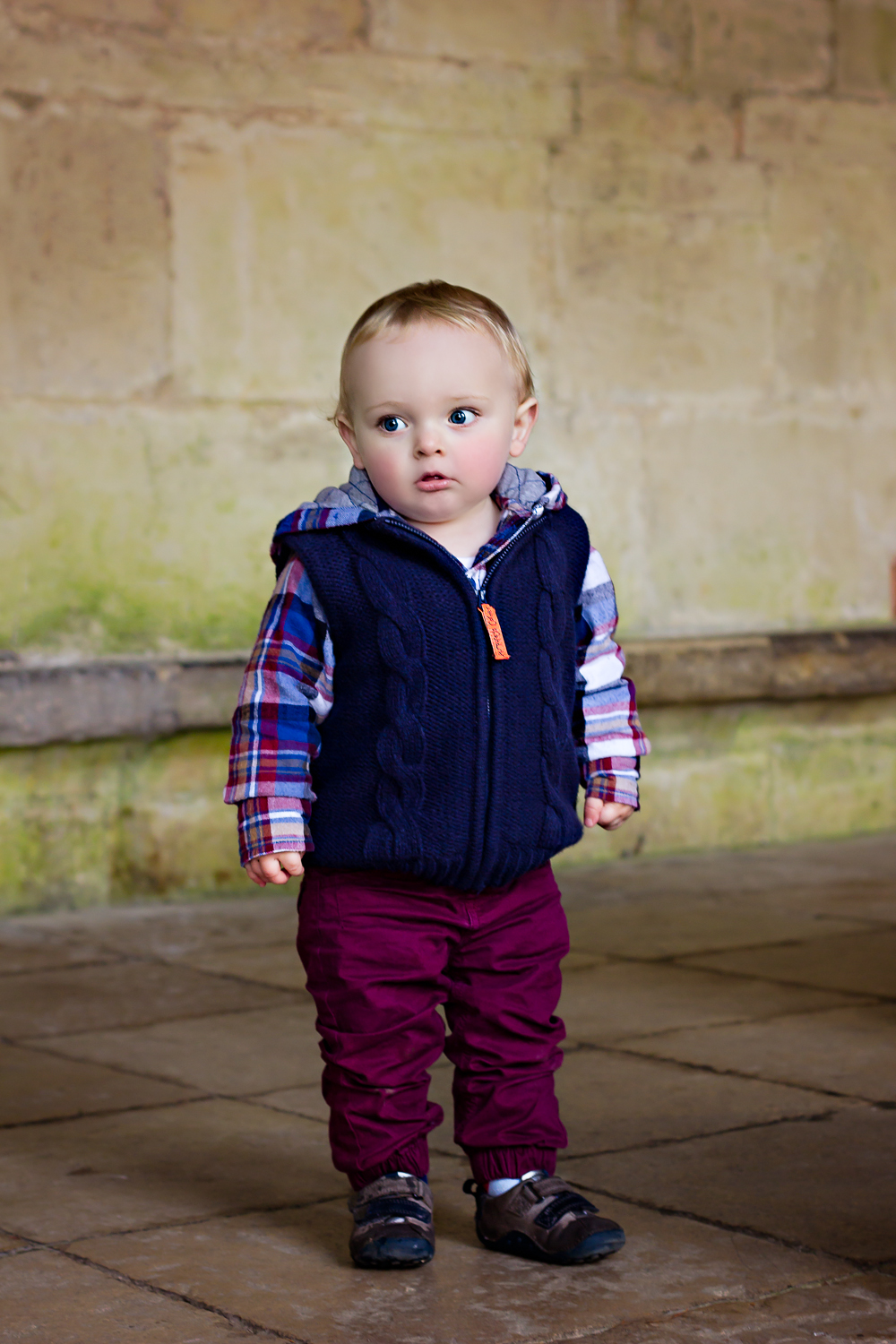 Baby boy at Salisbury Cathedral wearing cute winter clothes