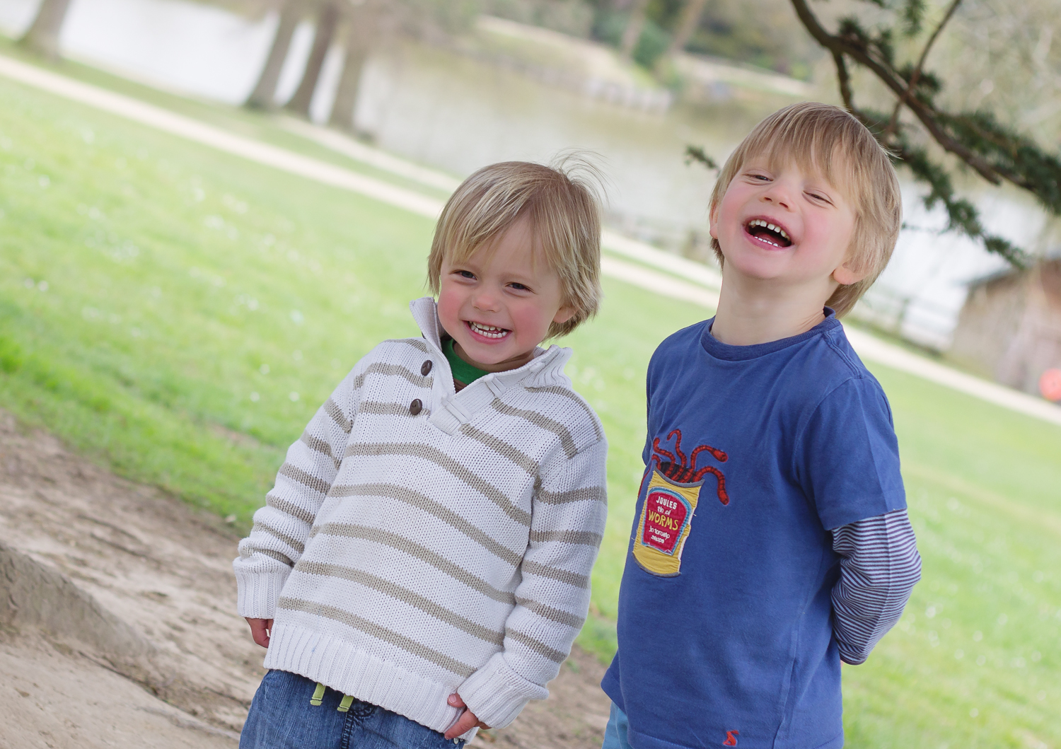 Two little brothers laugh together at Dunorlan Park