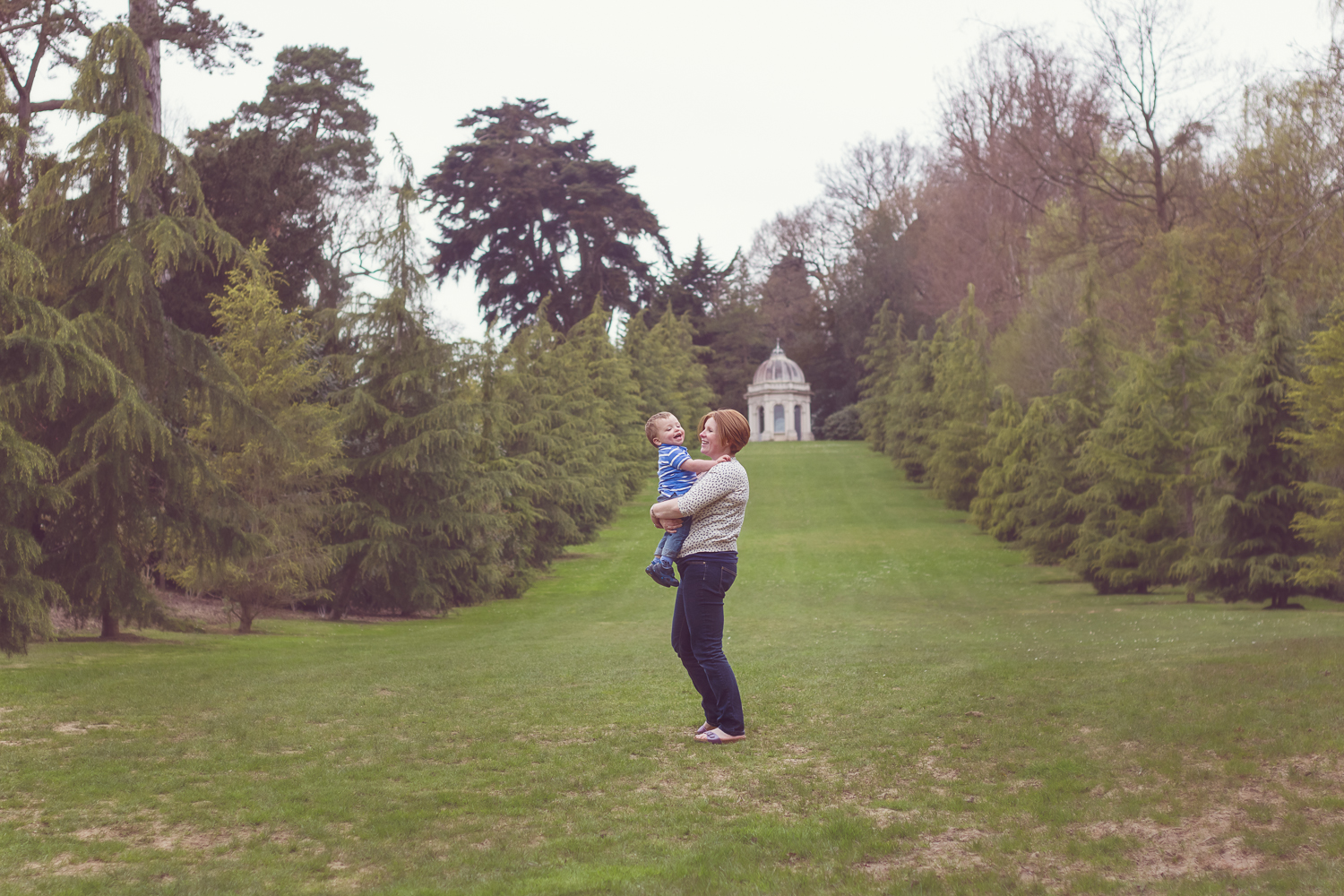 Landscape photograph of a beautiful Mama holding her 2 year old boy in Dunorlan Park near Chalybeate Spring