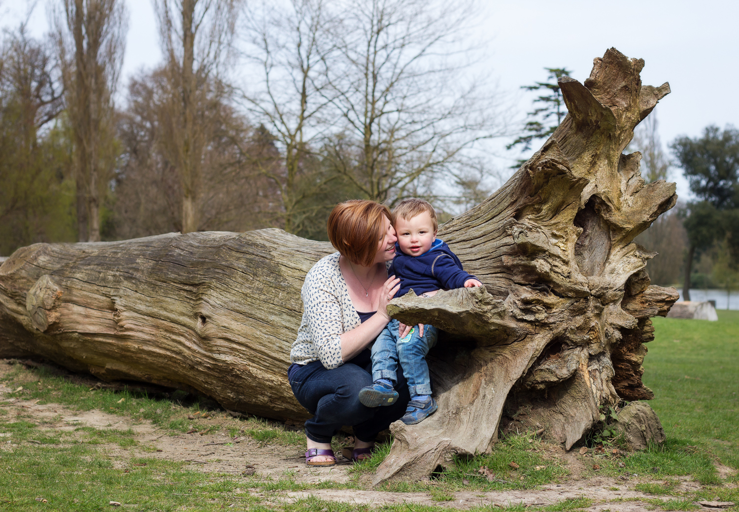 Portrait of a mum and her son by the big fallen down tree in Royal Tunbridge Wells Park