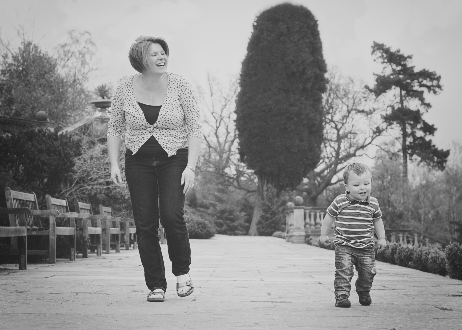 Mother and son laughing whilst walking along the pathway where the house used to stand at Dunorlan