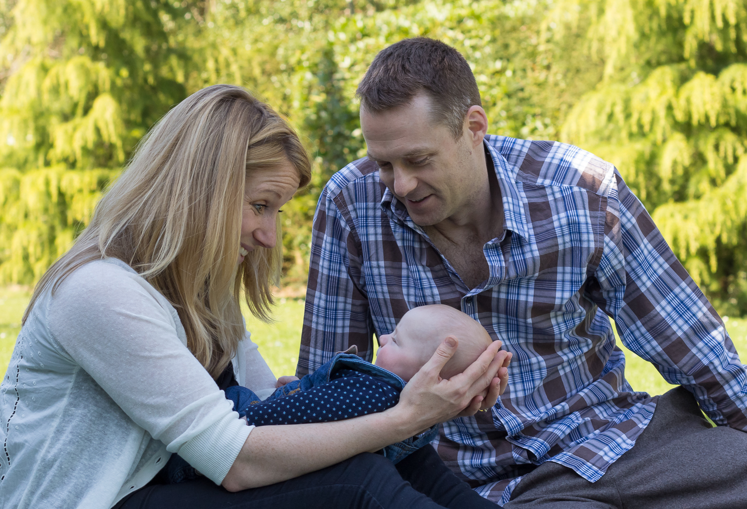 Close-up image of a Mum, Dad and baby boy on a family photoshoot at Dunorlan Park in Tunbridge Wells