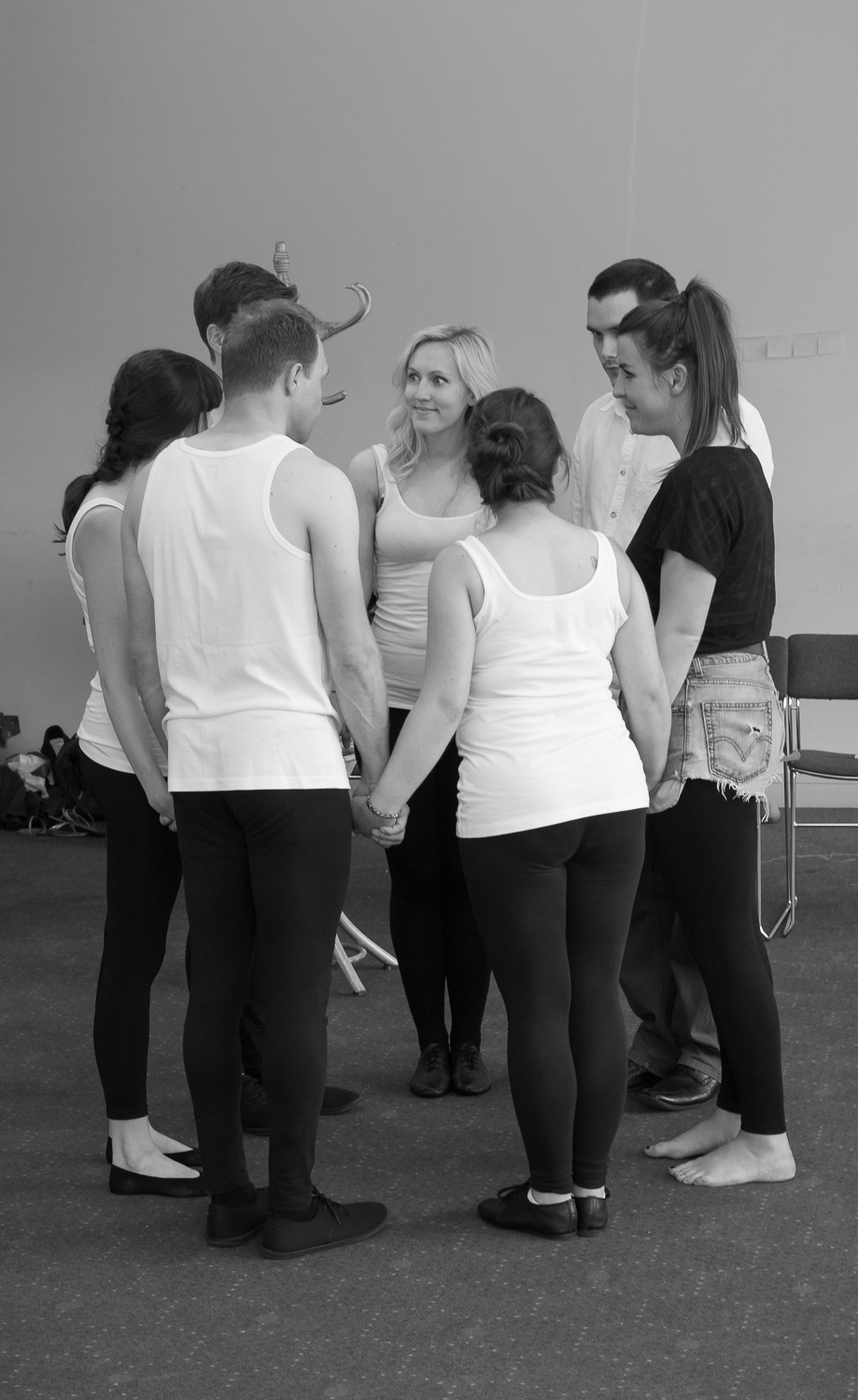 Ripped Script theatre company in rehearsals at Salisbury Playhouse in a group huddle to psych themselves up before the performance