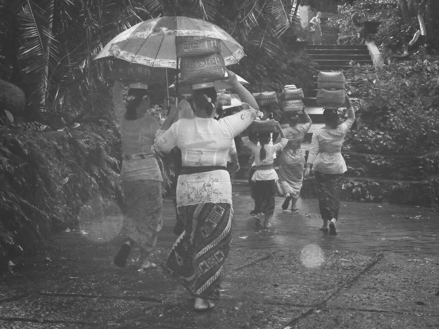 Balinese women carrying washing on their heads at the Monkey forest in Bali