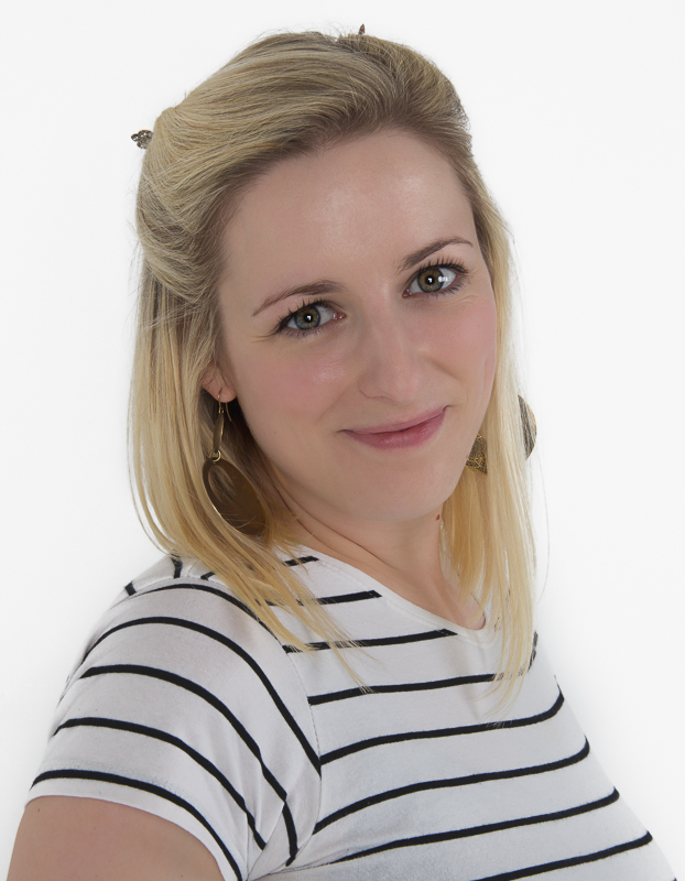 Headshot of Wedding, Lifestyle and Family photographer Susie Fisher wearing a black and white striped top.