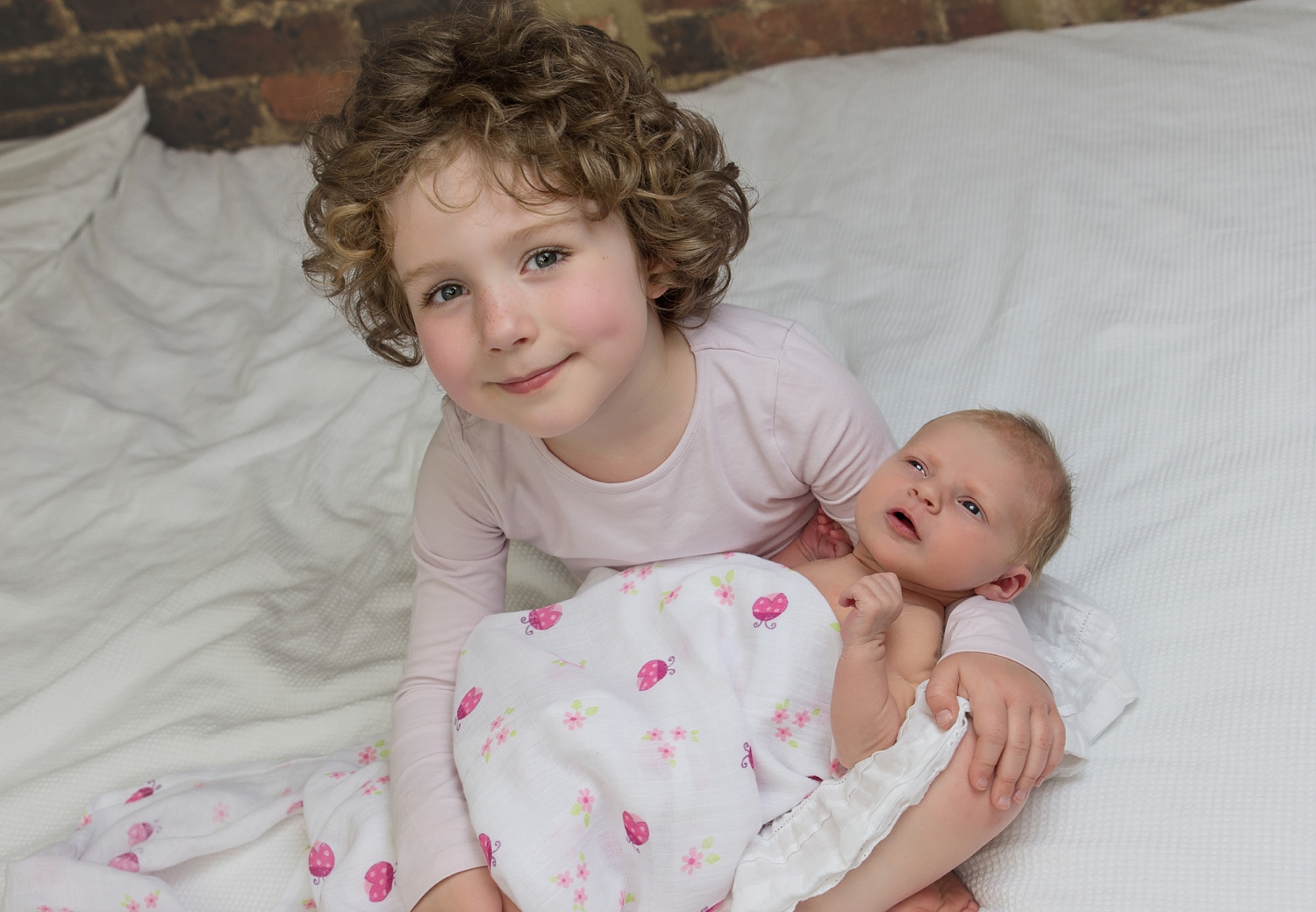 Woking Newborn and Sibling Photography_Copyright Susie Fisher Photography