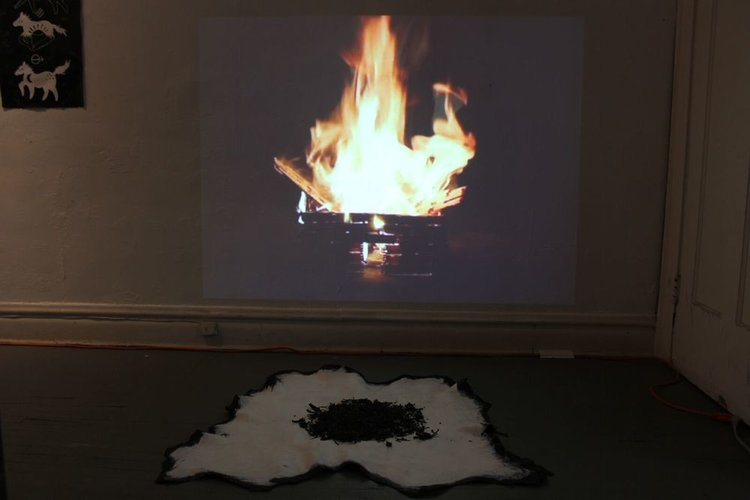 I'm Living In A Burning House , video installation with acrylic painted cow hide and ash