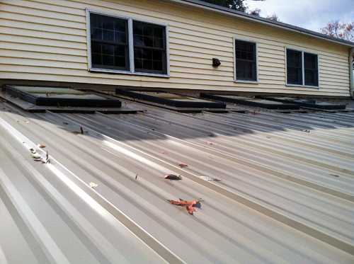 Photo 4: Superior Home Improvements: Metal Roof and Skylight Installation