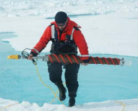 Researcher collecting Arctic ice core samples