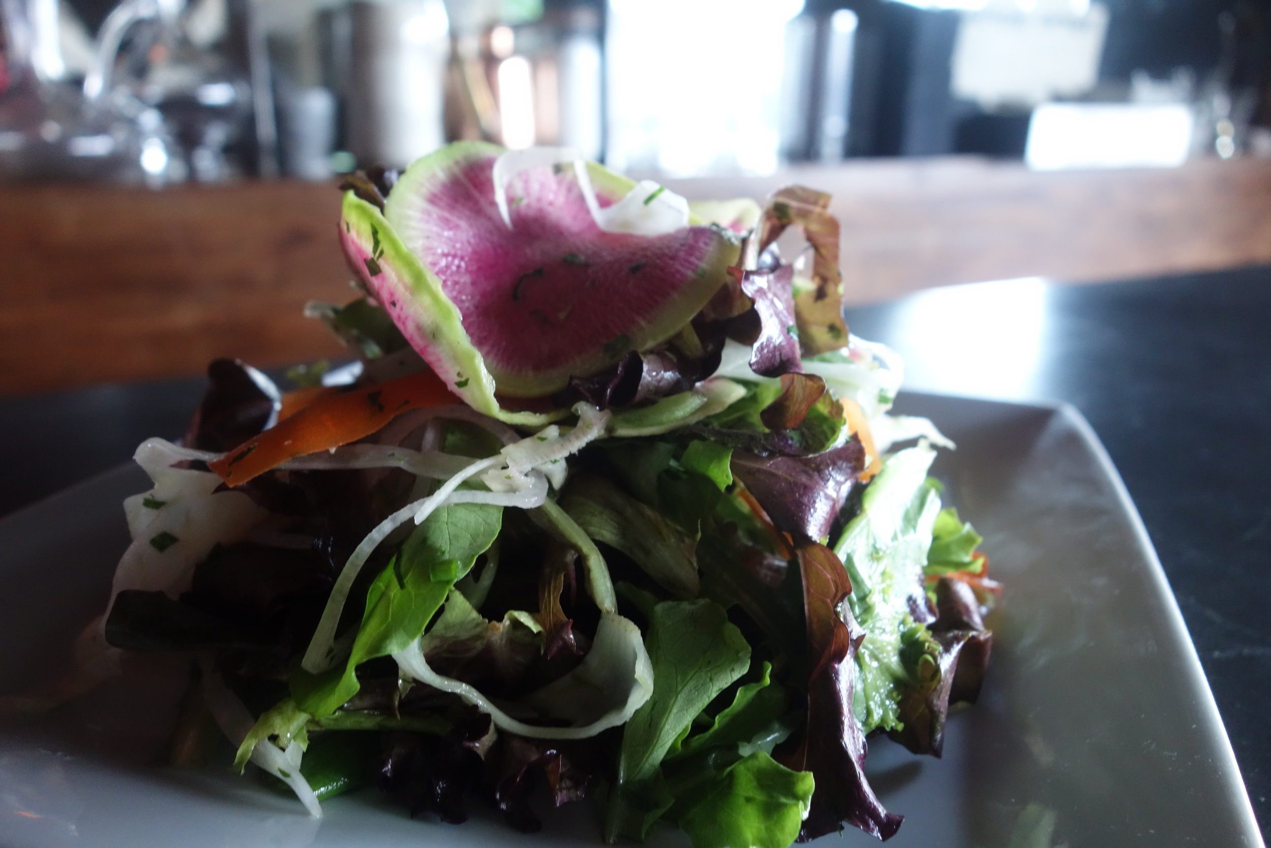 A simple, tasty spring mix salad with veggie crudite and lemon. (Photo by Nicole Reed)