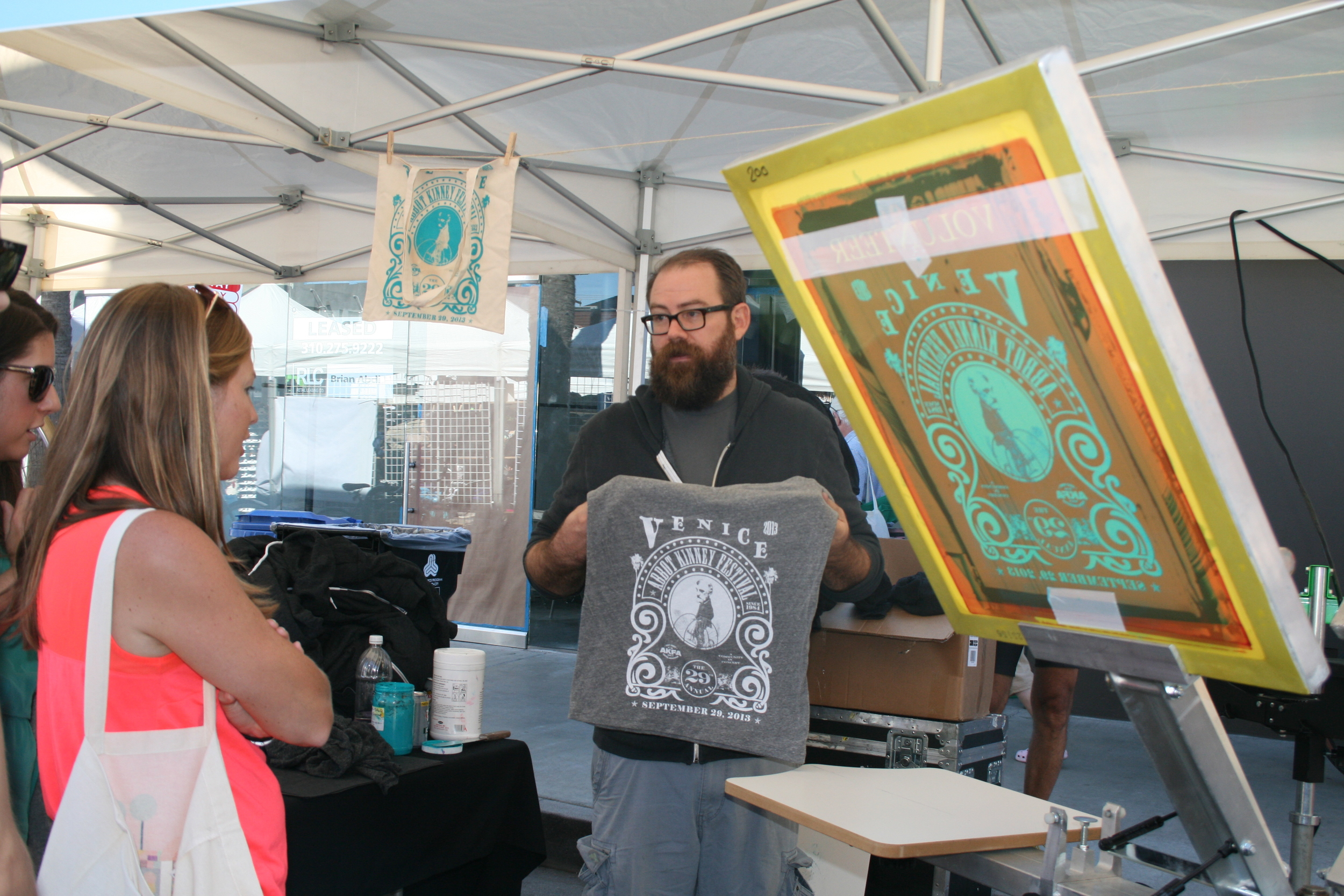 Abbot Kinney Festival merch table with live screen printing. (Photo by Kathy Urso)