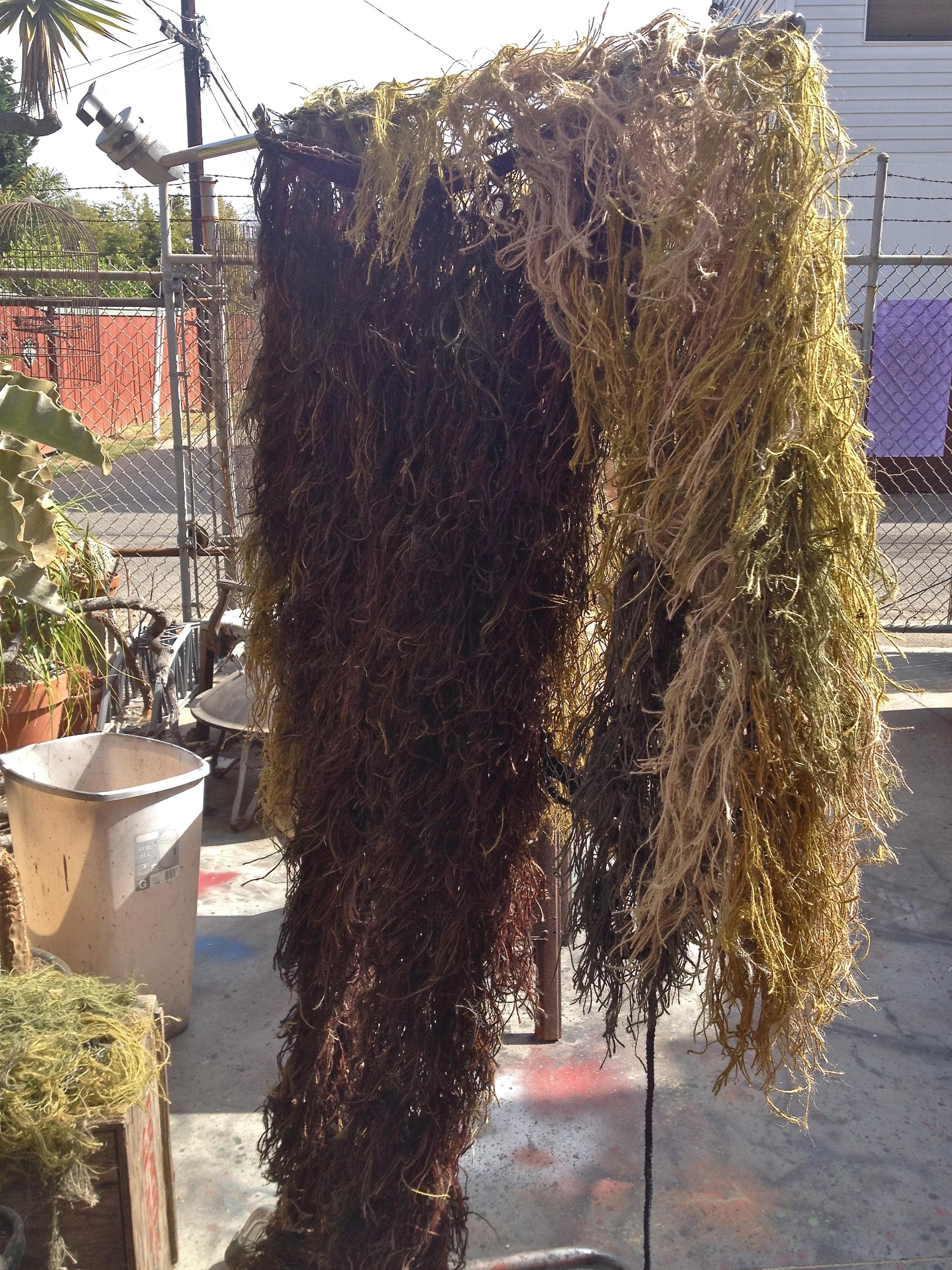 A monster carcass hangs in the backyard.