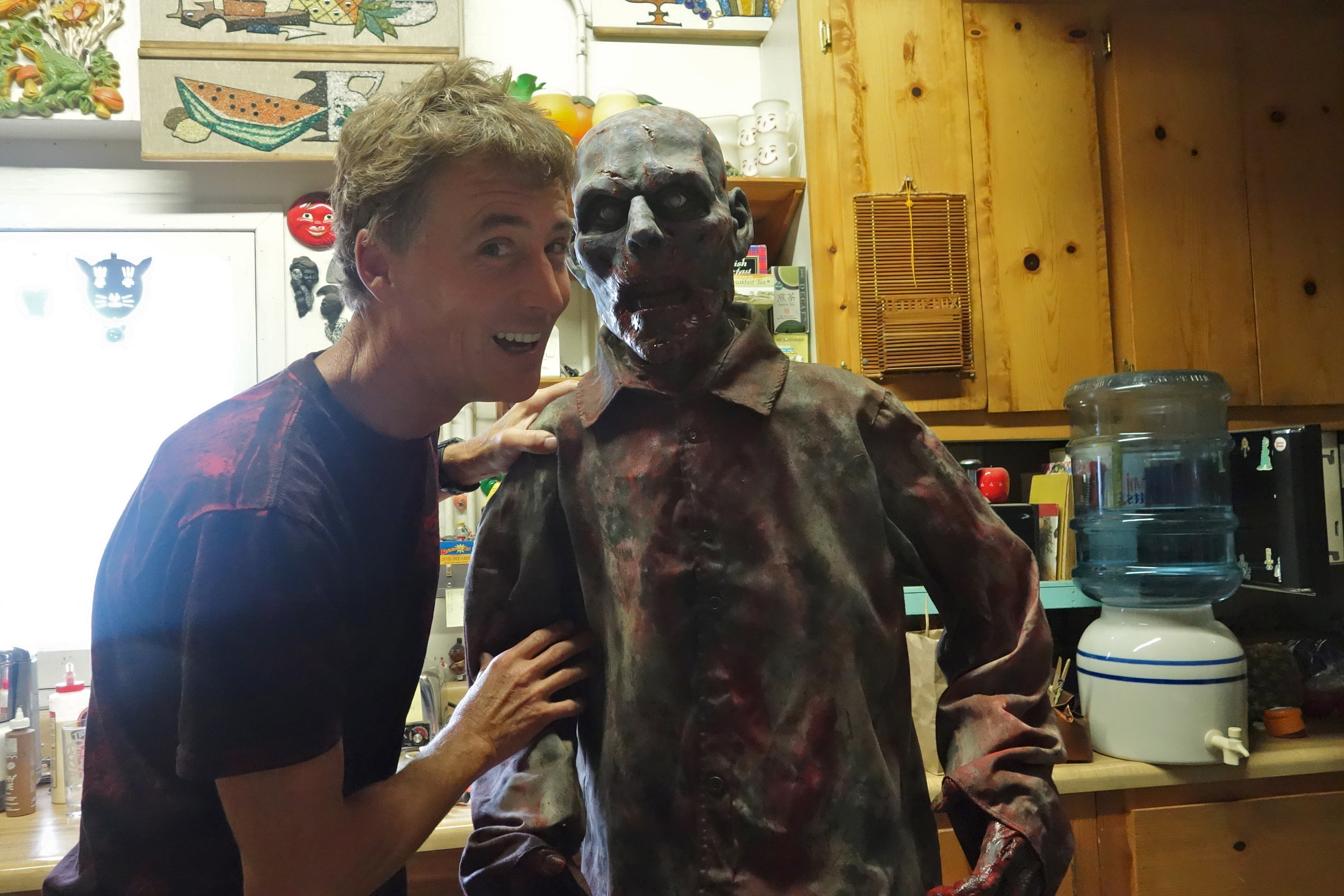 Steve Rose at home with a zombie in the kitchen.