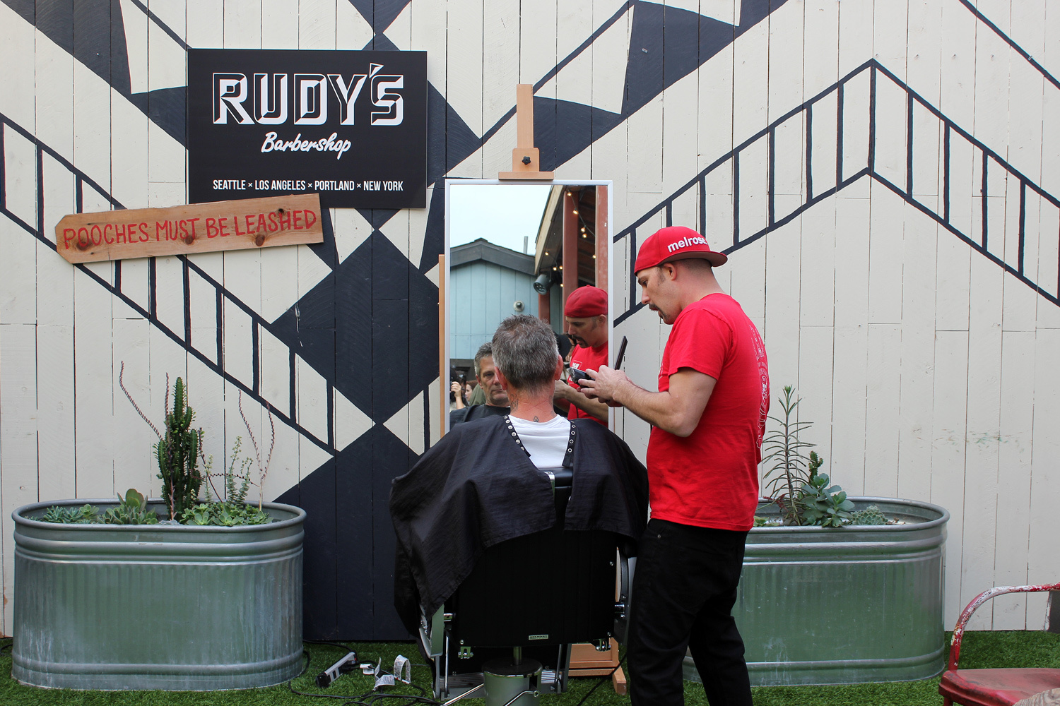 Free shave and a haircut at TOMS courtesy of Rudy's Barbershop. (Photo by Glennie Rabin)
