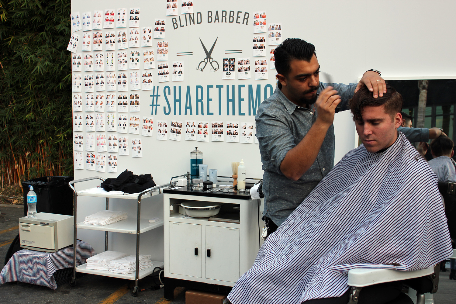 Blind Barber offers free shaves and haircuts at The Brig's #GQHQ lot party. (Photo by Glennie Rabin)