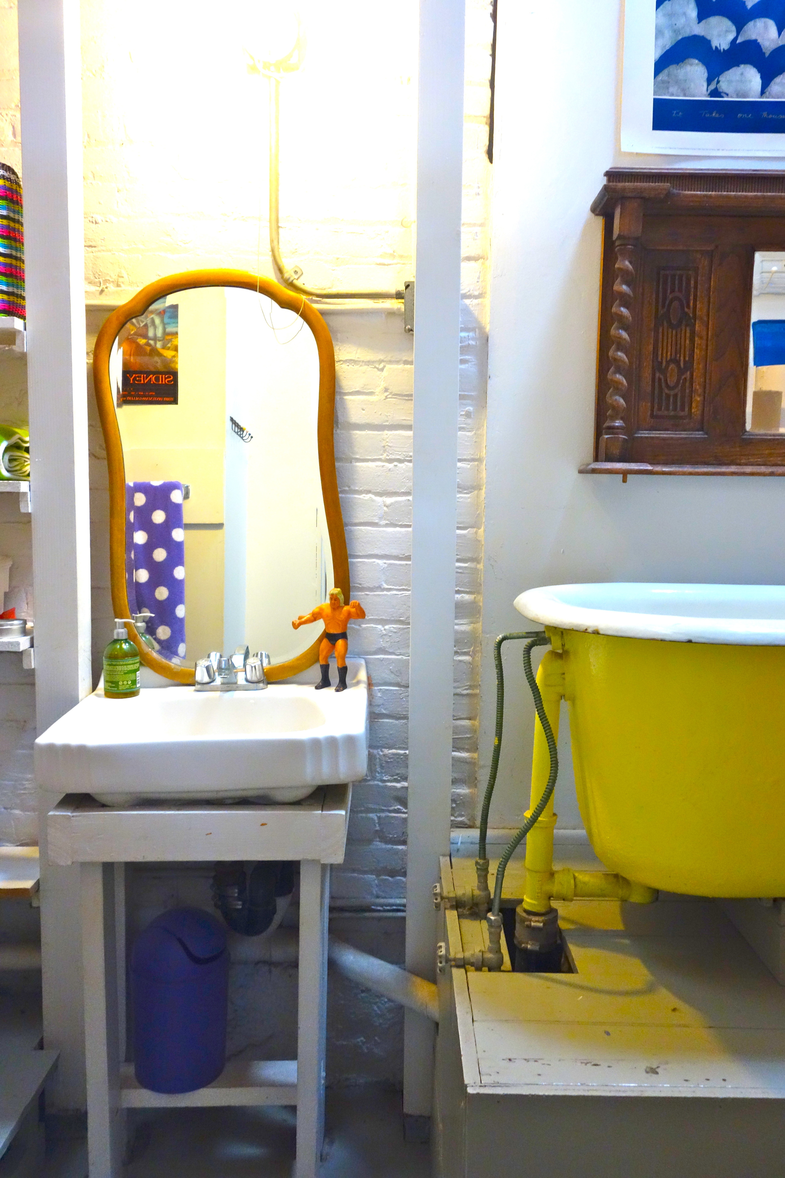 A clawfoot tub painted in sunshine yellow is where the Ripley's kids, and now grandkids, de-sand after a day at the beach.