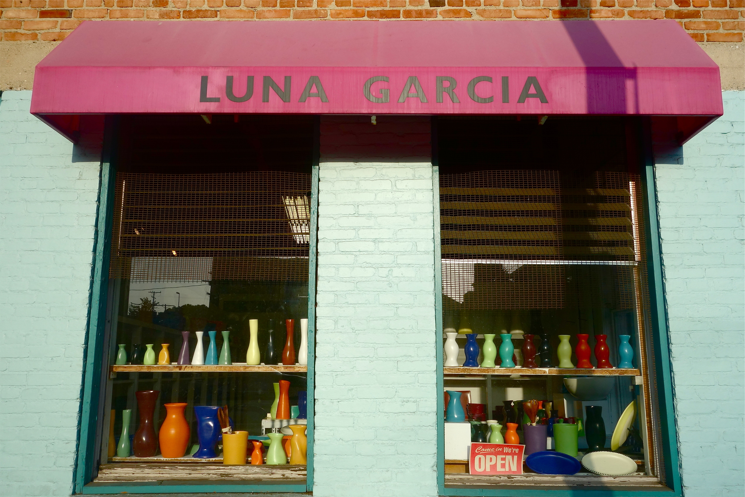 The modest Luna Garcia storefront at San Juan Ave. and Main Street hardly hints at the expansive showrooms and workspace behind its doors.