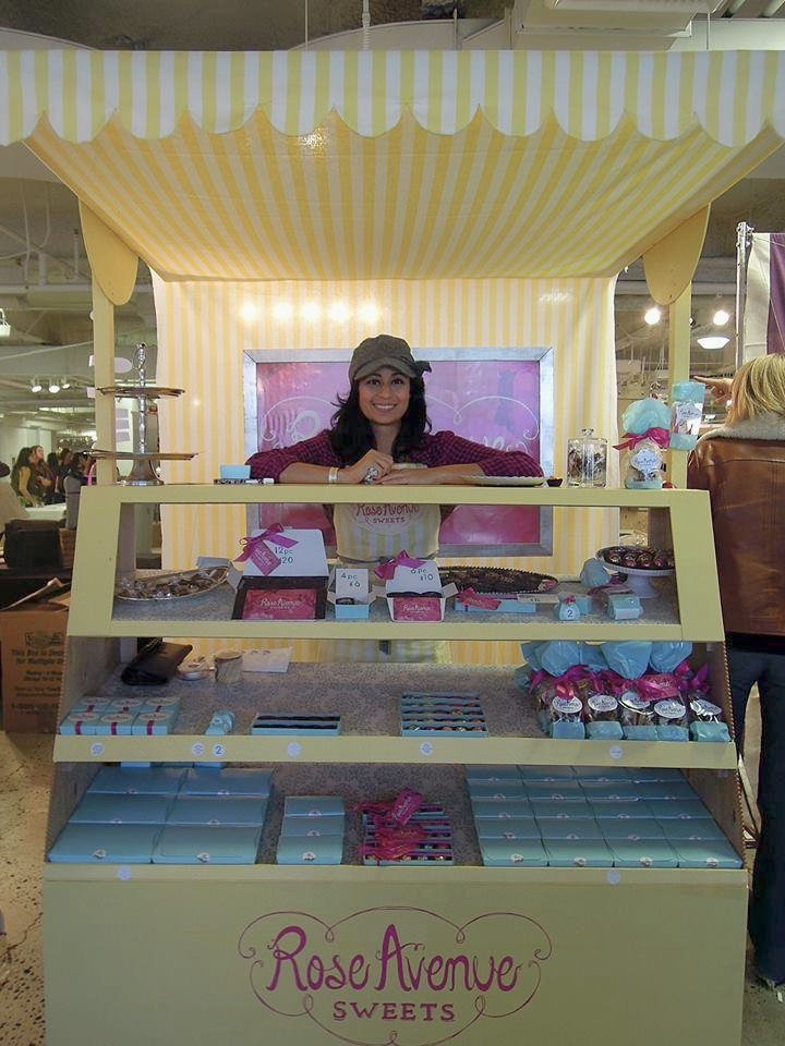 Rose Avenue Sweets booth made with vintage yellow and white striped wallpaper at  UniqueLA .