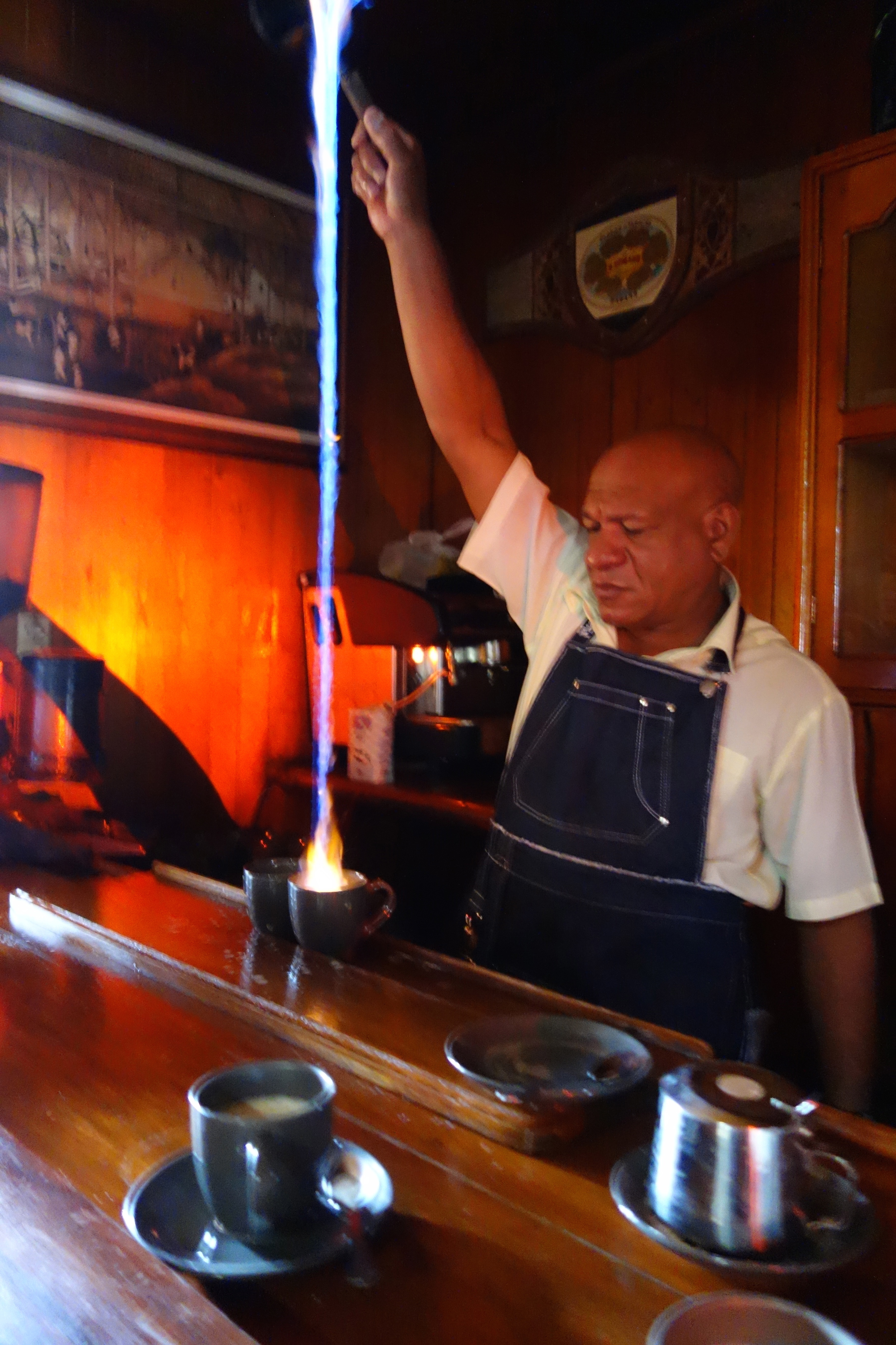 Inside the Legendario rum factory, the barista ignites rum and pours it into steamed milk for the most delicious spiked latte.