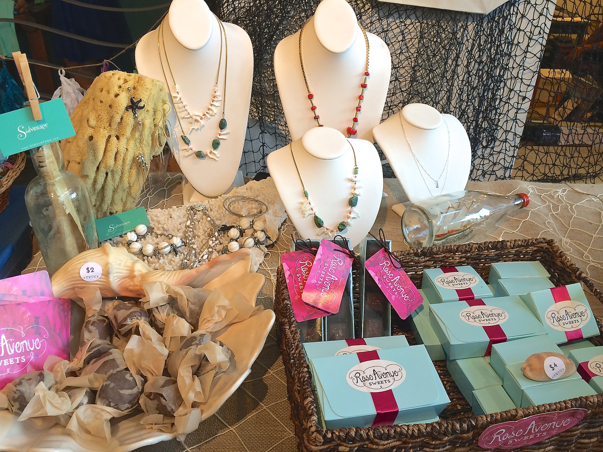 Mermaid treats. Coral and turquoise necklaces from Sid Vintage and sea salt caramels from Rose Avenue Sweets.