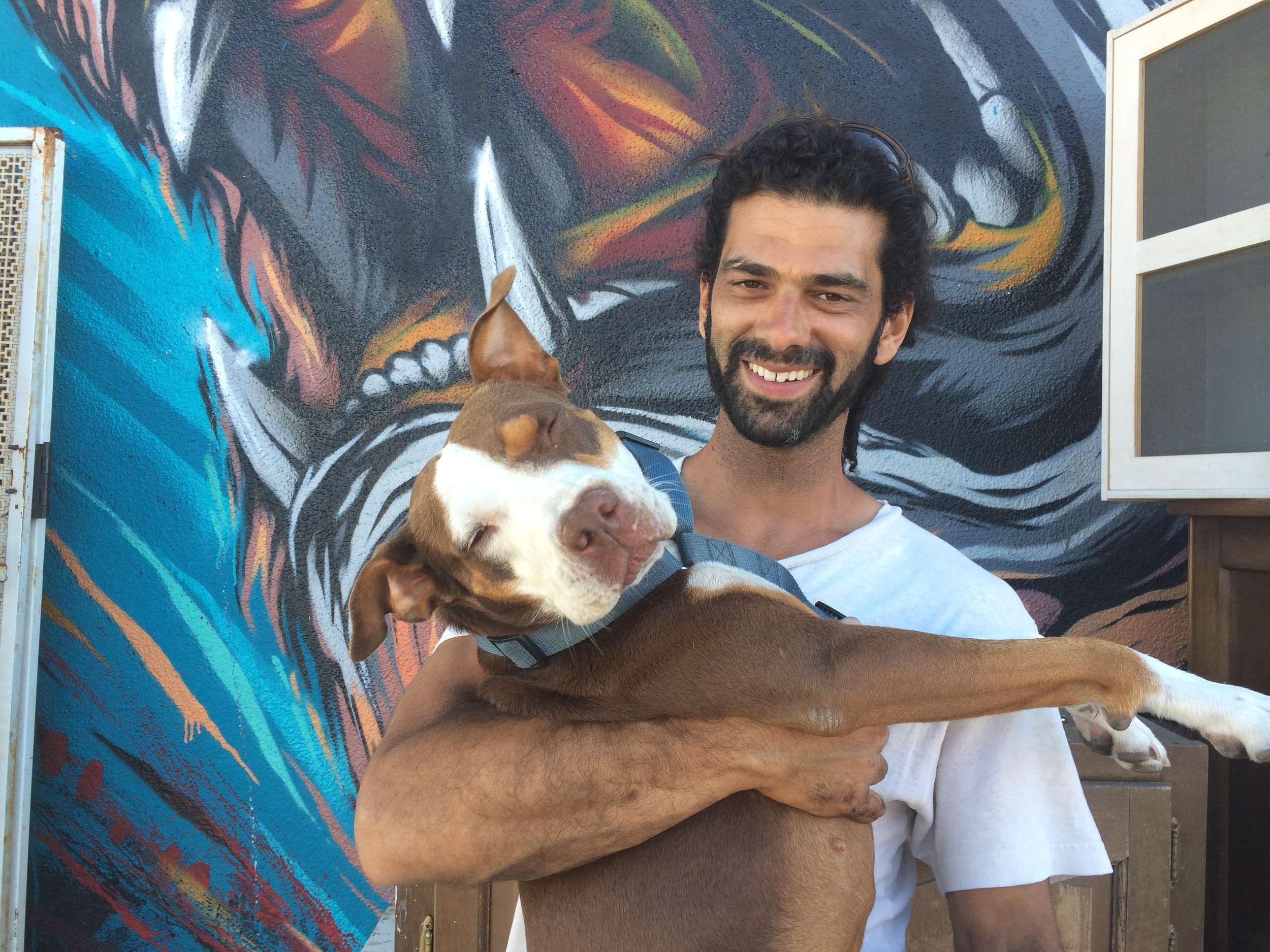 Love Shack owner Udi Levy (pictured in front of the Lion mural because he's a Leo) with bff Ella. In 2010, he turned A Bed For You mattress store into a beanbag shop and creative space.