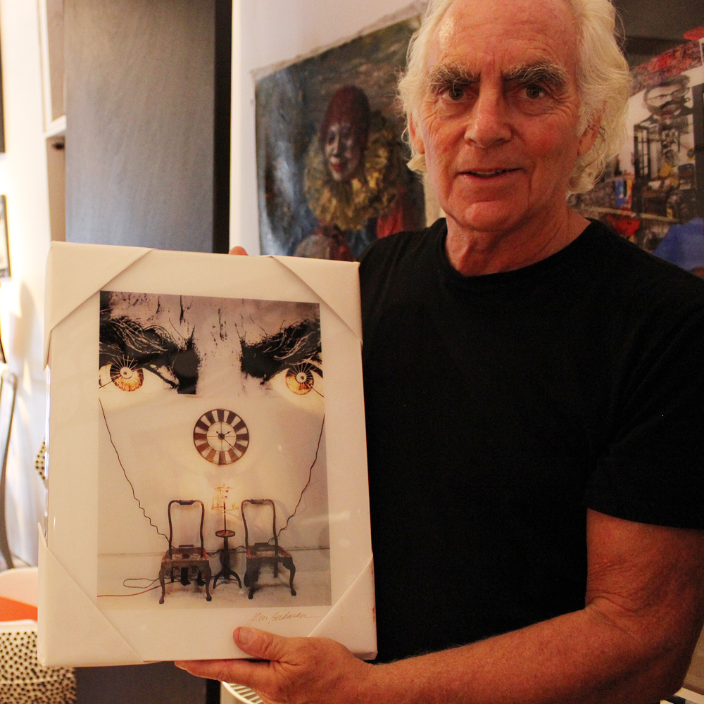 A photograph of Jim Budman's installation framed by his bushy brows.
