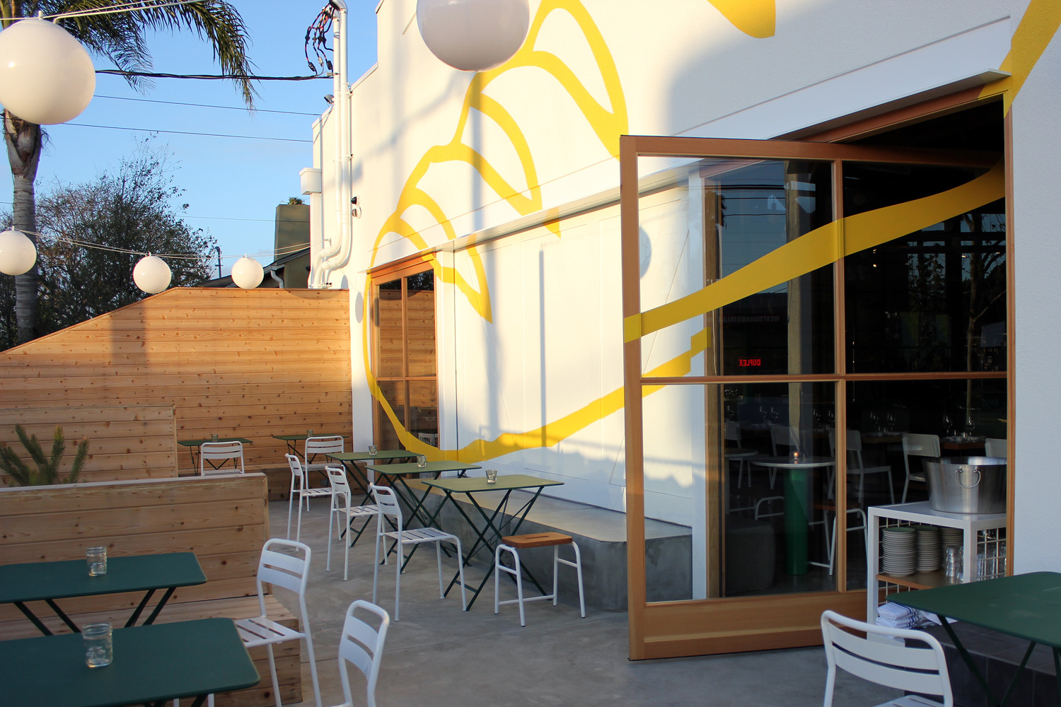 Indoor/ outdoor dining at its best can be found here at Superba Food & Bread, a converted auto shop on Lincoln Blvd. ( Photo by  Glennie Rabin  for Lincoln & Rose .)