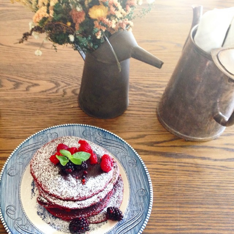 Red velvet pancakes with fresh berries. ( Photo by  @buttermilkinc . )