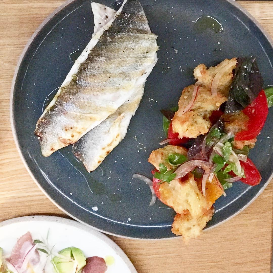 Loup de mer with heirloom tomato panzanella ( Photo by Nicole Urso Reed )