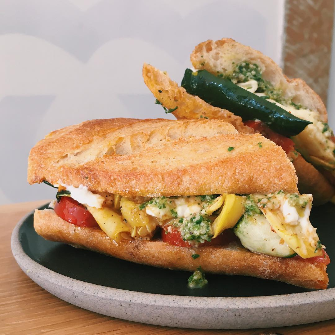 Roasted squash Caprese sandwich with basil pesto on a fresh baguette from Superba Food + Bread.