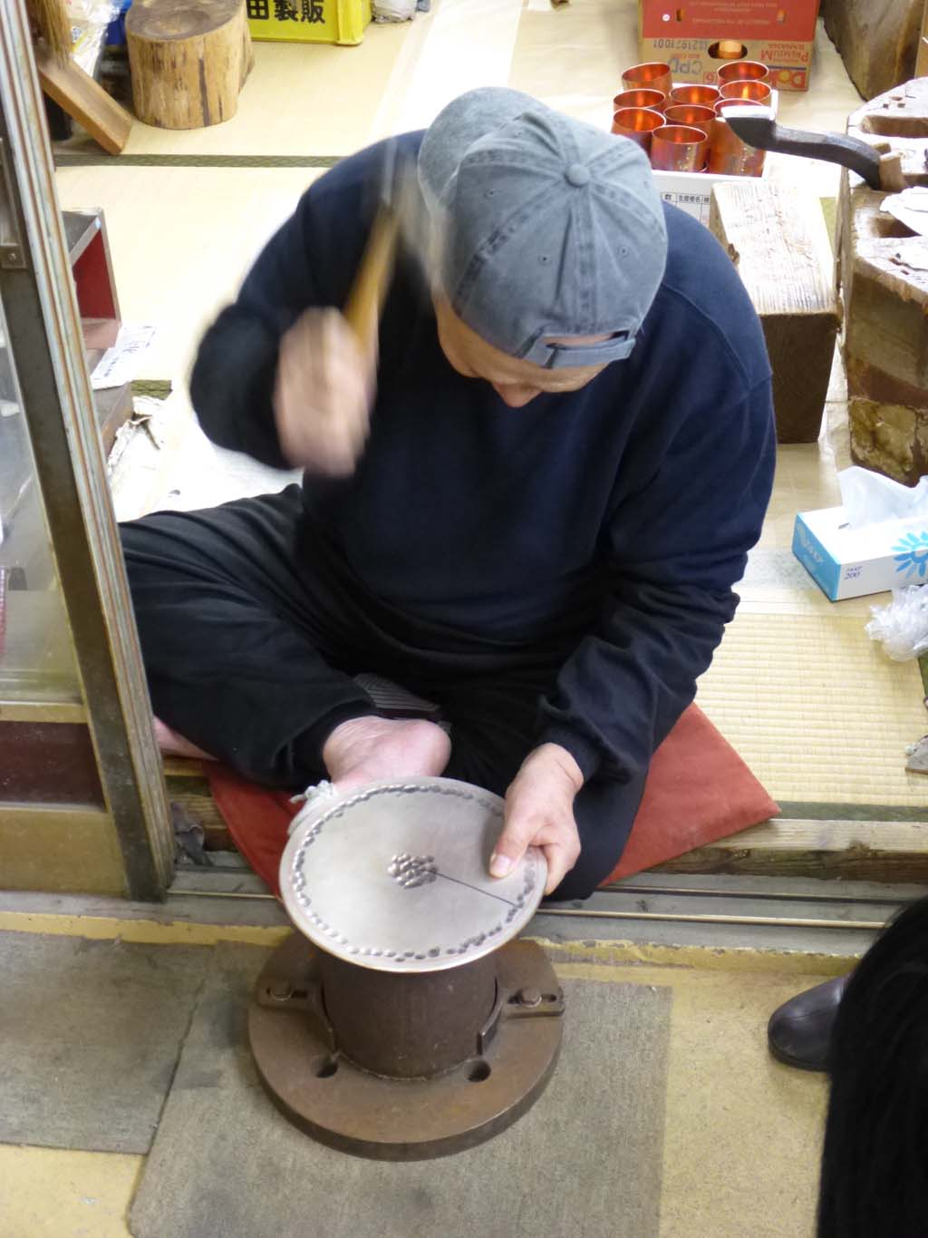 Uemo-san demonstrating how he begins raising a 5mm thick sheet of shibuichi.