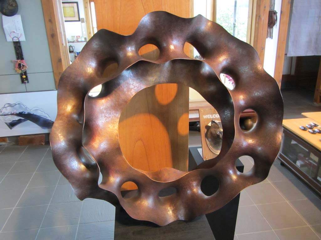 A large copper sculpture that Ryota made during his graduate studies. This is about 3 feet across.