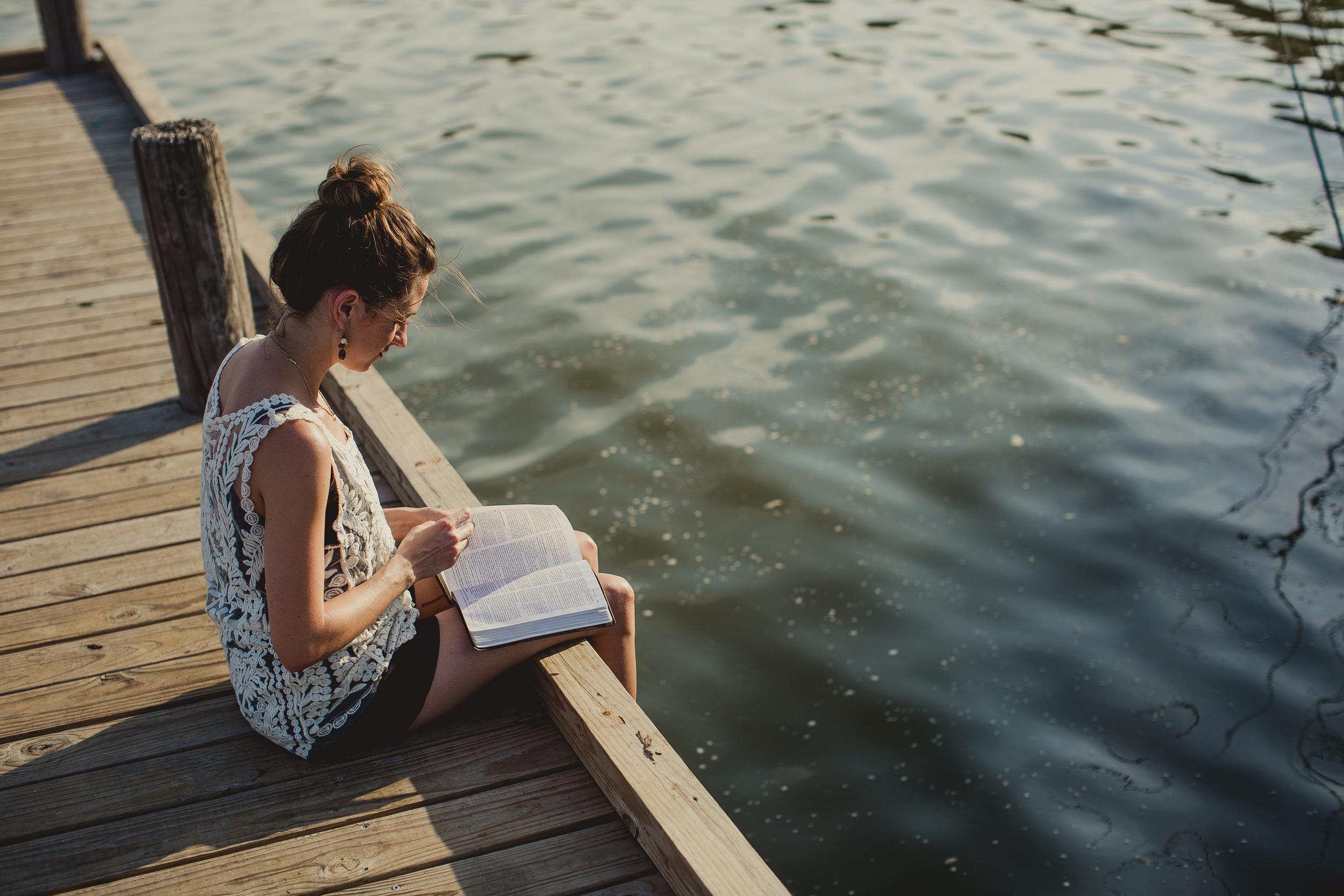 Girl Reading Bible at lake.jpg
