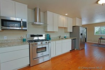 A sprawling ranch style house with 4288 square feet upstairs. Featuring two master bedrooms, each with attached master baths. The other two bedrooms share a large bathroom featuring a dual-sink vanity. The expansive kitchen features a pass thru to the dining room. The sunken living room shares a fireplace with the dining room and includes an abundance of custom cabinetry. The house has completely updated kitchens including granite, shaker cabinets, and stainless steel appliances. The four bathrooms are also completely updated. The 1120 square feet in the finished basement features a family/media room, bathroom with sauna and an over-sized laundry room. This house also features a two car attached garage with workshop and two patio spaces featuring an outdoor bar and gas fire pit.