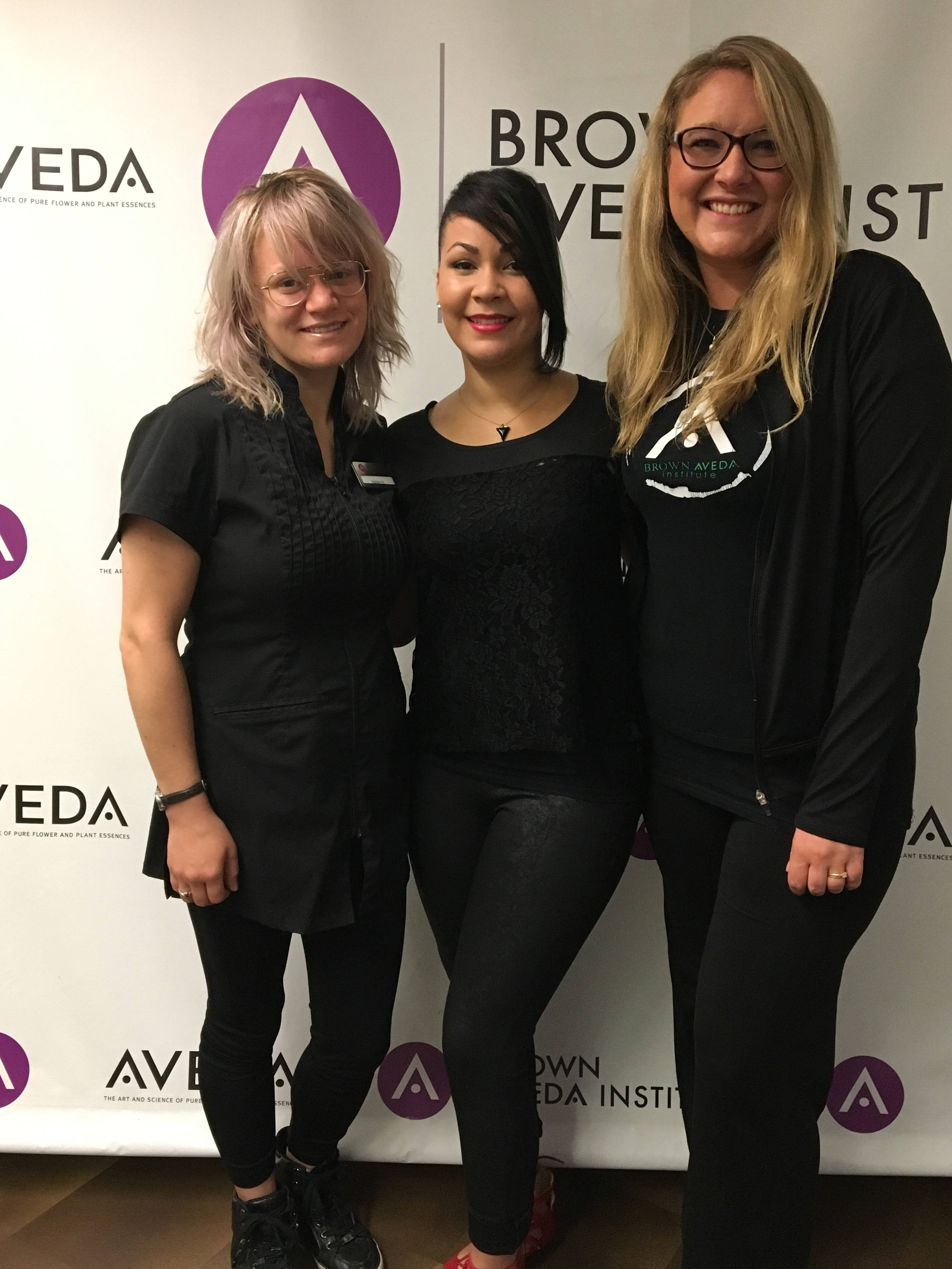 Brown Aveda student Hailey Hughes, educator Rose Marie Benitez, and student Dasha Olecki will be attending AVEDA's Midamerica show on September 30.