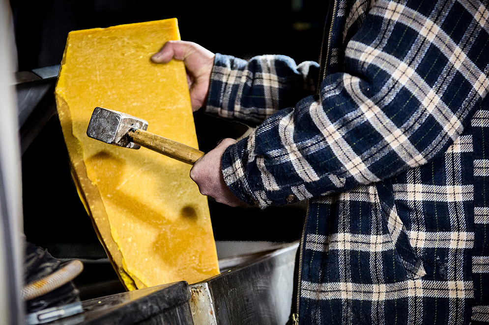 1.  Lumps of natural beeswax are placed in drums of natural turpentine and heated