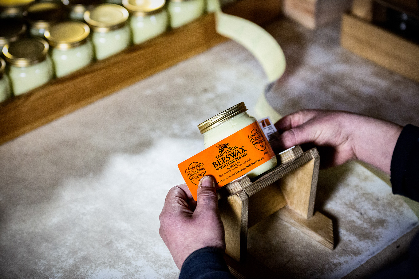 Labeling jars of hand made beeswax furniture polish - Cambridge Traditional Products