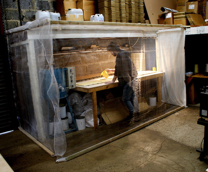 Factory area enclosed with insect mesh to stop bees killing themselves in the wax - Cambridge Traditional Products