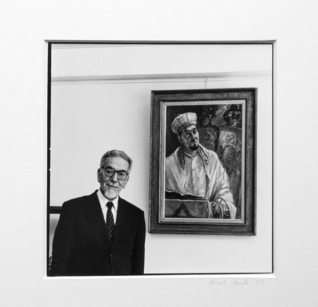 Rabbi in front of his portrait