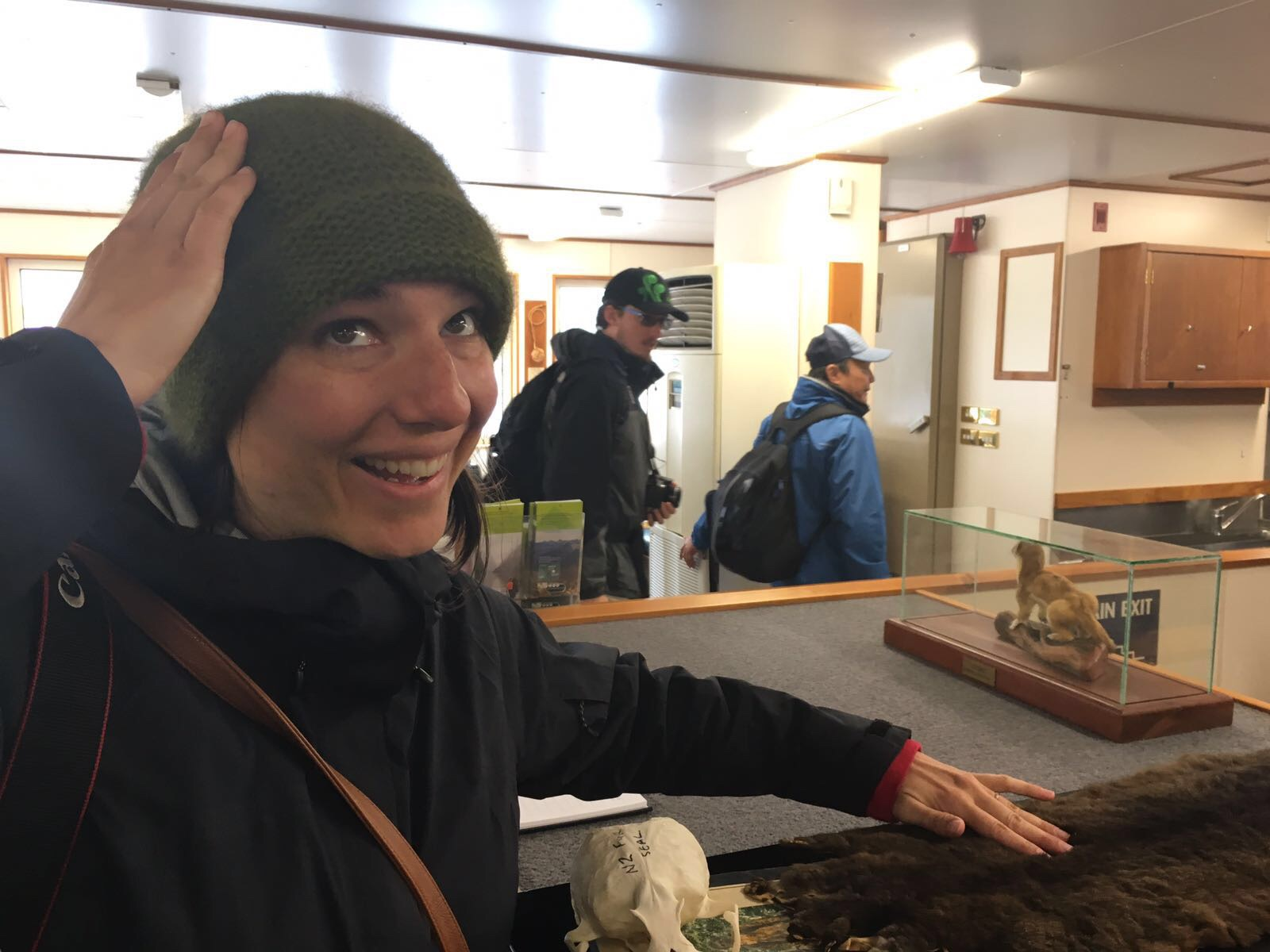 Coincidentally there was a possum skin on our Milford Sound Nature cruise. I had just gotten the possum hat, so I was clearly amused. Adam was super excited about this photo request.