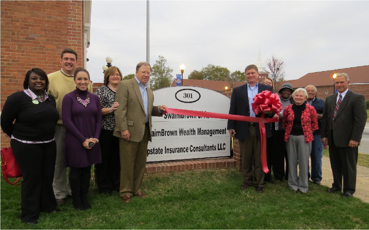 PRESS RELEASE, November 2013:    Austin Johnson and associate, David Ramage of Upstate Insurance Consultants cut the Laurens County Chamber of Commerce grand opening ribbon on Tuesday, November 12. This business, located at 301 A North Broad Street Clinton, looks forward to serving Laurens County.
