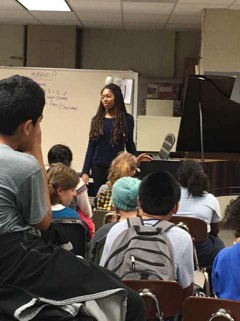 Isata speaks and plays at Cesar Chavez School.