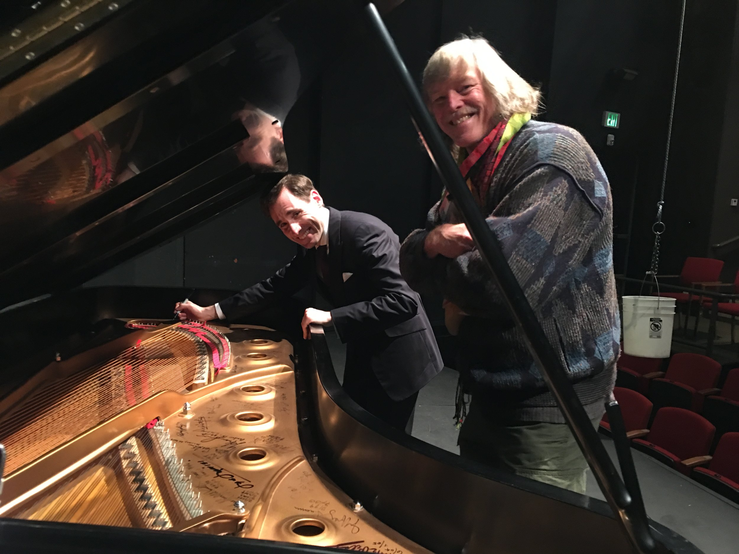 Boris signs the performance piano, loaned to Portland Piano International by Board member, Larry Vollum.