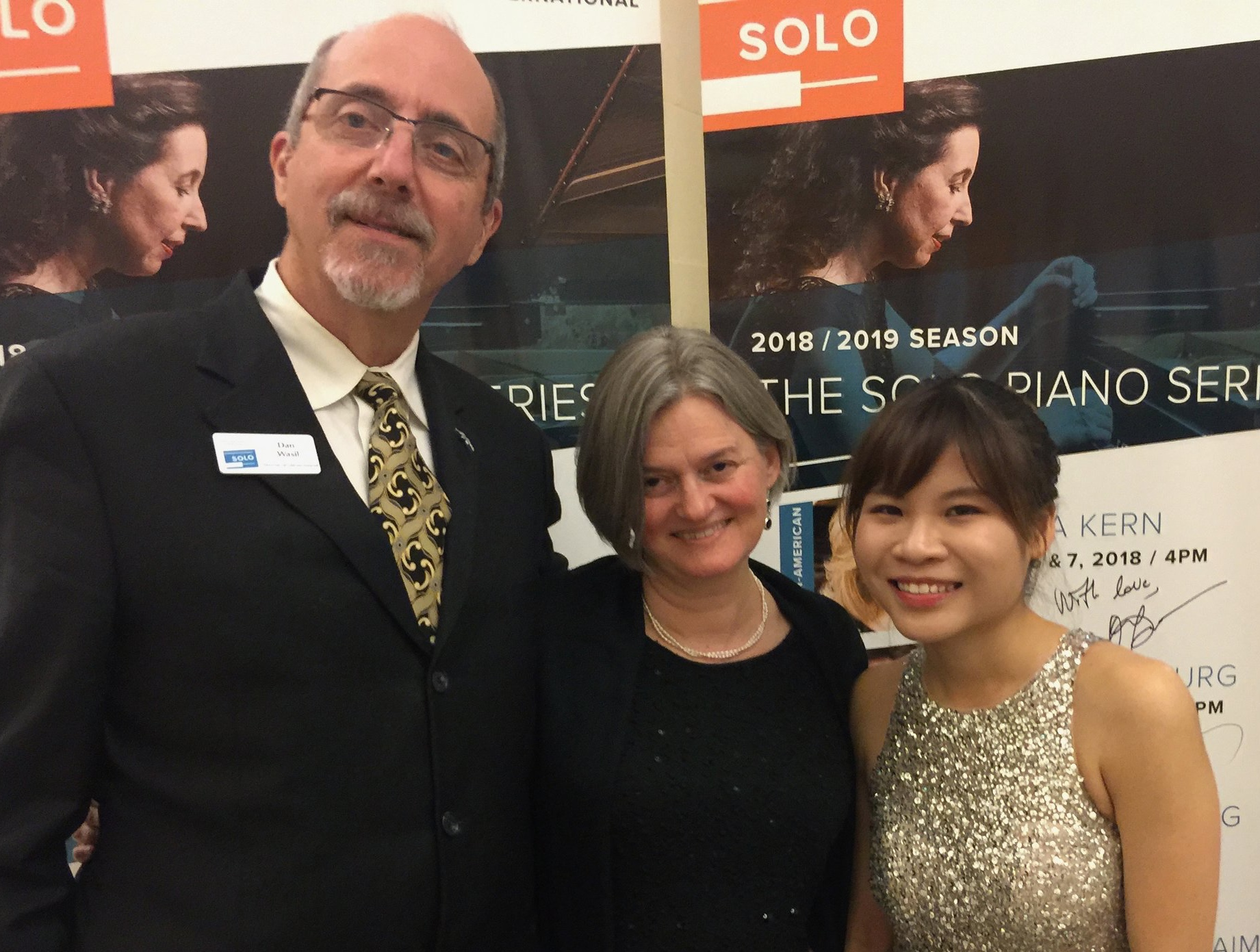 Rachel poses with Dan Wasil, director of advancement and Ellen Bergstone Wasil, executive director following her Sunday recital..