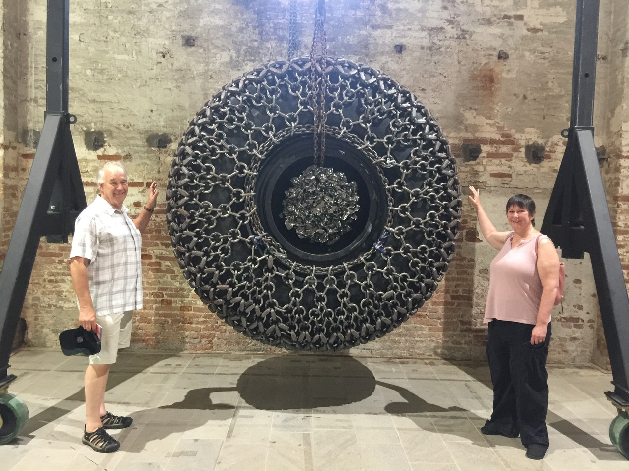 "Michael McCulloch and Maryellen Hockensmith next to one of the Biennial sculptures. The theme of the exhibition this year is ""May You Live in Interesting Times""."