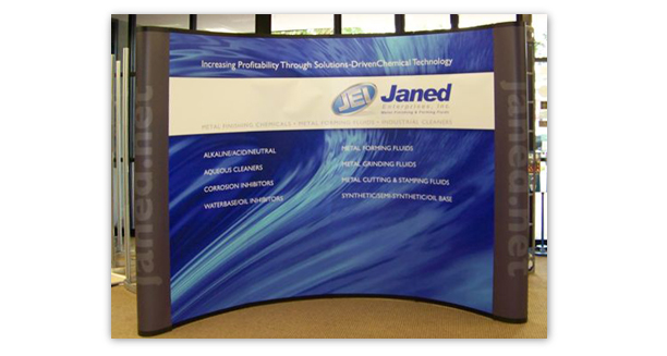 """Janed Enterprises booth panel. This 10"""" x 8"""" graphic shows that this company is in the chemical business. We put their key selling point and types of products they manufacture for the manufacturing industry."""